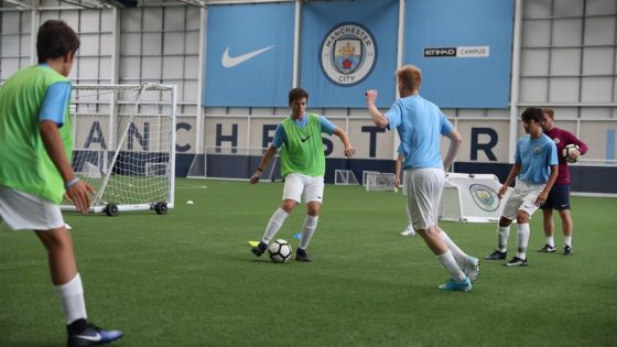 1. CFLS - Boys Feature Image - Training on the Full-Size Indoor Pitch at the City Football Academy
