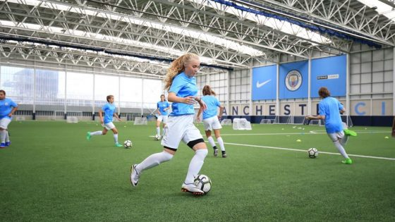 1. CFLS - Girls Feature Image - Training on the Full-Size Indoor Pitch at the City Football Academy